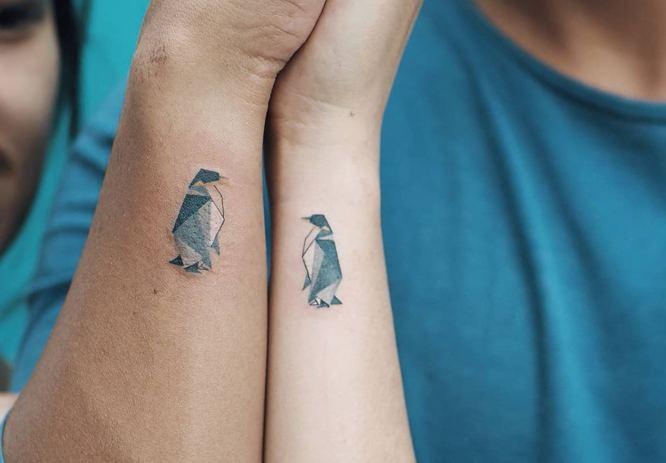 tatuajes pareja pingüinos