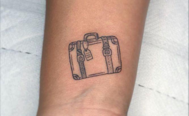 tatuajes viajes maleta