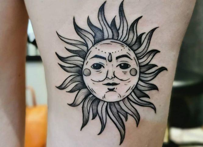 tatuajes sol pierna