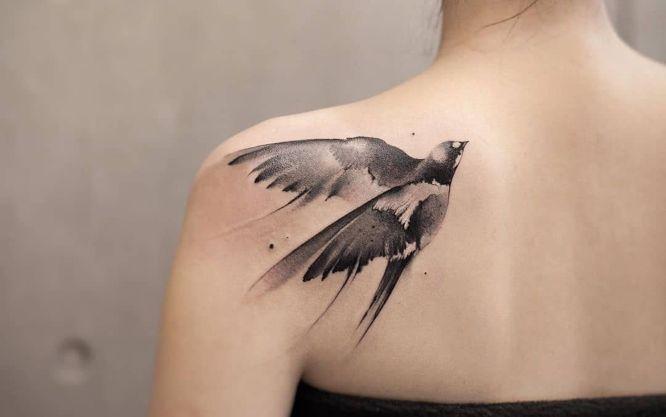 tatuajes golondrina mujer