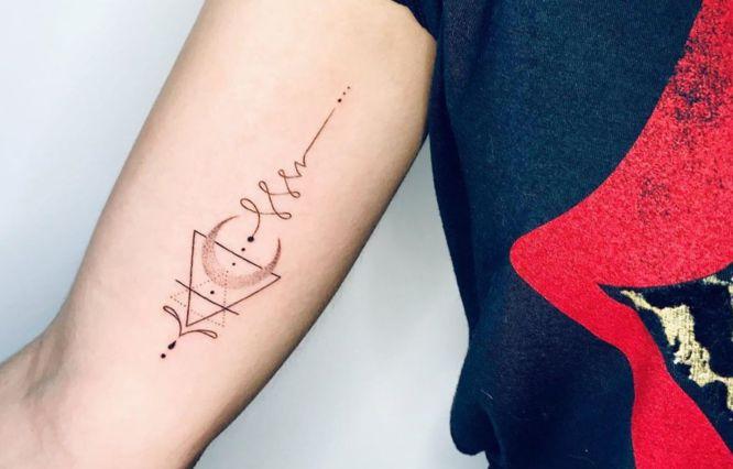 tatuajes unalome brazo chica