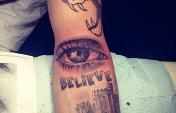 tatuajes justin bieber ojo antebrazo