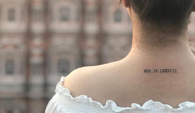 tatuajes nuca chica numeros romanos
